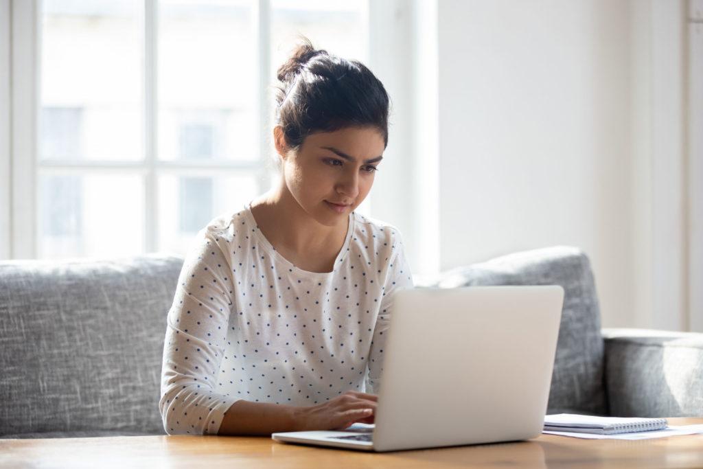 Woman looking up website