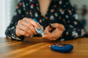 Woman checking insulin